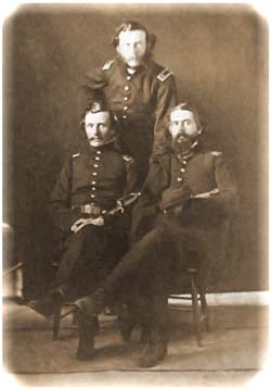 Crawford, standing behind a seated Lt. Theodore Talbot at left and Lt. Truman Seymour at right, as photographed in beleaguered Fort Sumter by George S. Cook on February 8, 1861. (MOLLUS)