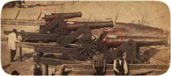 "Two 24-pounders and a 32-pounder along Moultrie's eastern parapet, with ""aprons"" draped over their vent-holes, April 1861"