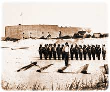 A platoon of Confederate volunteers, photographed by Edwards while neatly paraded in early afternoon just west of Fort McRee, ca. late April or early May 1861. A sliver of distant Santa Rosa Island can be glimpsed at the left-hand edge of this picture, on the opposite shore of the harbor-entrance. (Miller, Photographic History, Volume 8)