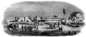 Engraving showing the arrival of the first heavy guns at Camp Defiance on May 28, 1861; note the accurately-sketched triangular gun-carriages, a barbette-chassis laying on its side, a mortar-bed, etc. (Harper's Weekly)