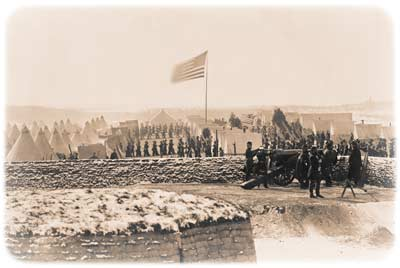 View eastward from inside Fort Richardson, looking over the encampment of the 4th Connecticut Infantry on a windy day, with the Potomac River and District of Columbia faintly visible in the distance, late 1861; the regimental officers are posing at right, clustered around a 30-pound Parrott gun. (Library of Congress)