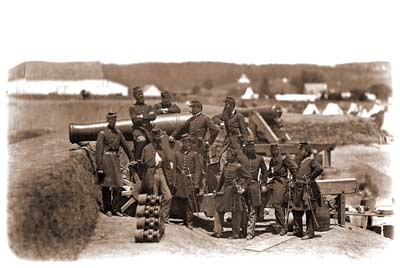 Officers of the 69th New York State Militia posing atop a M.1845 24-pounder barbette-carriage in Fort Corcoran, Virginia, probably in early July 1861; note the ten grapeshot rounds stacked in the immediate foreground. (U.S. National Archives)