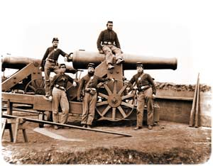 Five-man gun-crew posing informally atop of an M.1829 barbette-mounted 32-pounder gun — allegedly members of the 3rd Massachusetts Heavy Artillery Regiment toward the Civil War's end in Fort Totten northeast of Washington, D.C., although more likely members of the 2nd Pennsylvania Heavy Artillery in Fort Lincoln, ca. 1862. Click anywhere on this image to see an alternate photo. (Library of Congress)