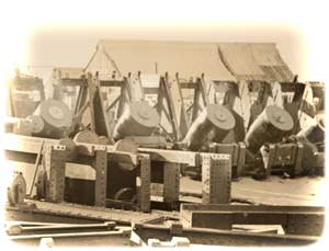 Four 10-inch seacoast mortars, stockpiled amid dozens of iron barbette-chassis and empty shells in the Union ordnance depot on Morris Island, South Carolina, toward the war's end; a photograph attributed to Samuel A. Cooley, taken in March or April 1865. (Library of Congress)
