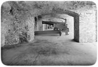 Side-view of the lower tier of casemate gun-positions at the Southwest Quadrant of Fort Sumter, demonstrating the thickness of its masonry walls and columns. (Library of Congress)