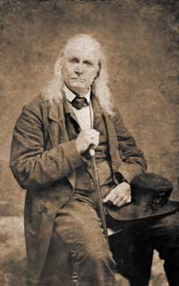 Edmund Ruffin as he appeared in mid-April 1861 — at 67 years of age — in one of numerous poses which he struck in the immediate aftermath to Fort Sumter's surrender, for the Charleston photographer Charles J. Quinby