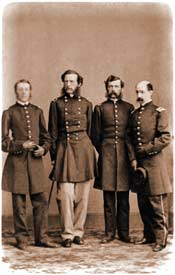 Crawford at the end of his convalescence, posing with a cane among his staff-officers — probably in Mathew Brady's studio in Washington, D.C., ca. February 1863